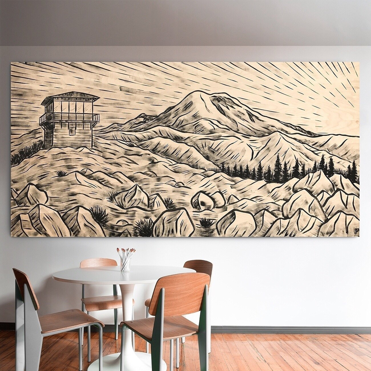 Painting of a fire lookout and Mt. Rainier on wood in an office